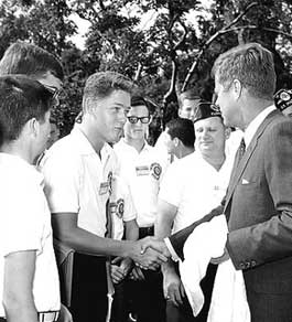Bill Clinton in the White House Rose Garden shaking hands with President Kennedy on July 24, 1963. He was in Washington, D.C. as a delegate from Arkansas to the Boys Nation Convention. The photograph was taken by Arnie Sachs of Consolidated News Pictures
